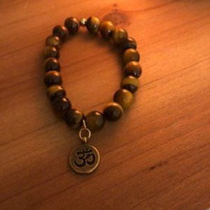 Tigers eyes 10 mm Bead Bracelet with Om Charm